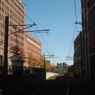 Waterfront Line weaves between big old industrial buildings