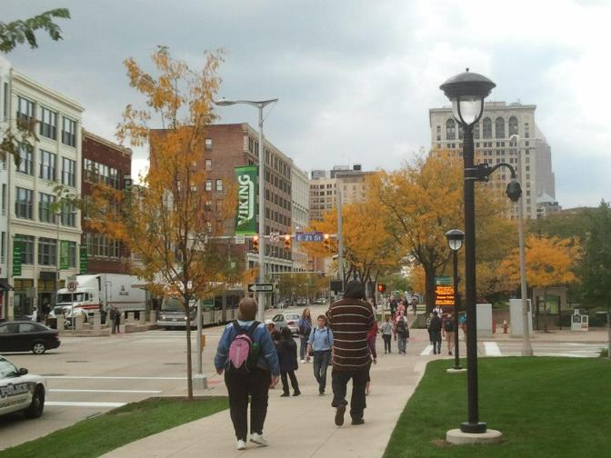 Students, foliage, and BRT on the CSU campus