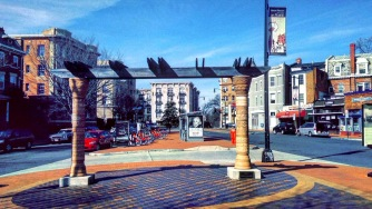 Bikeshare, streetscape, and bus island in Mt Pleasant, two blocks across 16th